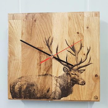 Oak wall clock with stag print
