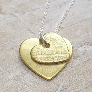 BRASS DOUBLE HEART PENDANT DETAIL